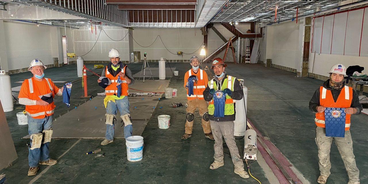 Members working on Rinaldi Tile & Marble job