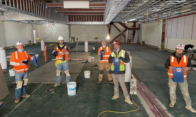 Members working on Rinaldi Tile & Marble job